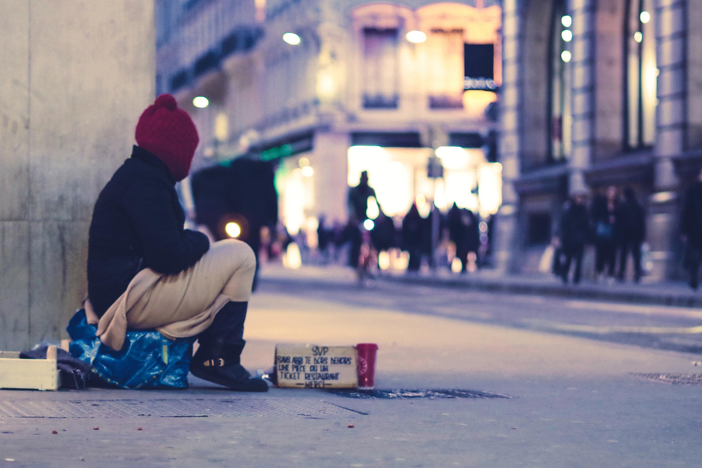 homeless man on busy street