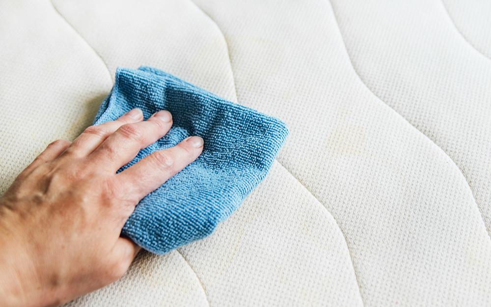 Man cleaning a mattress