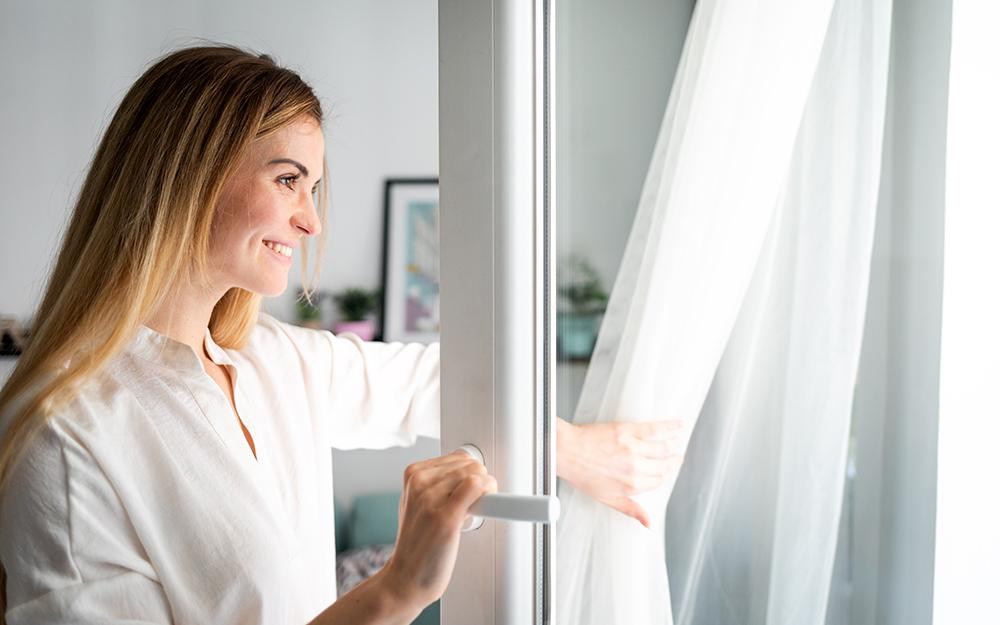 Woman opening windows