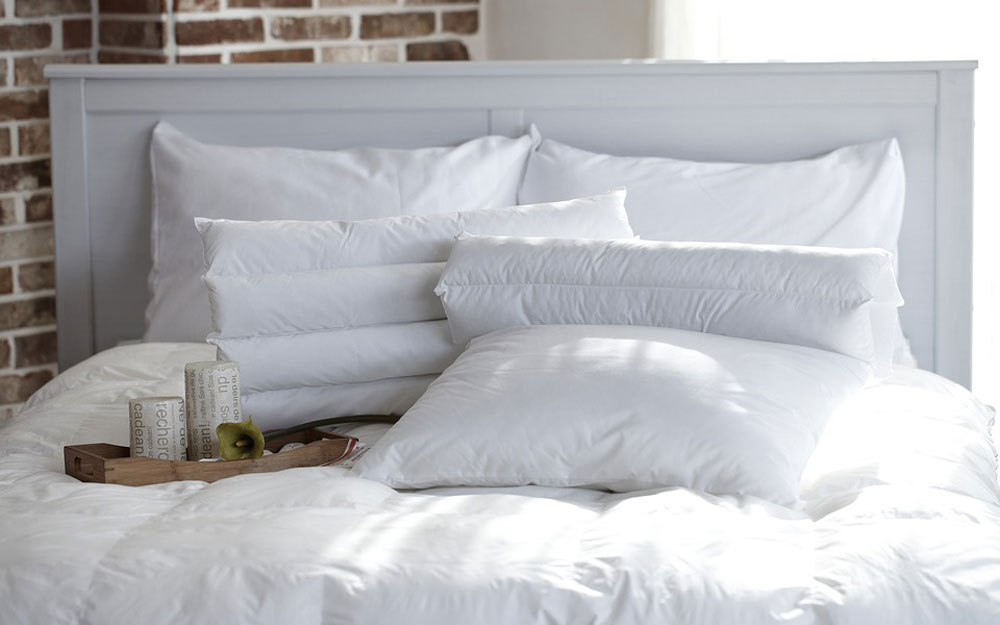 White pillows and tray on bed