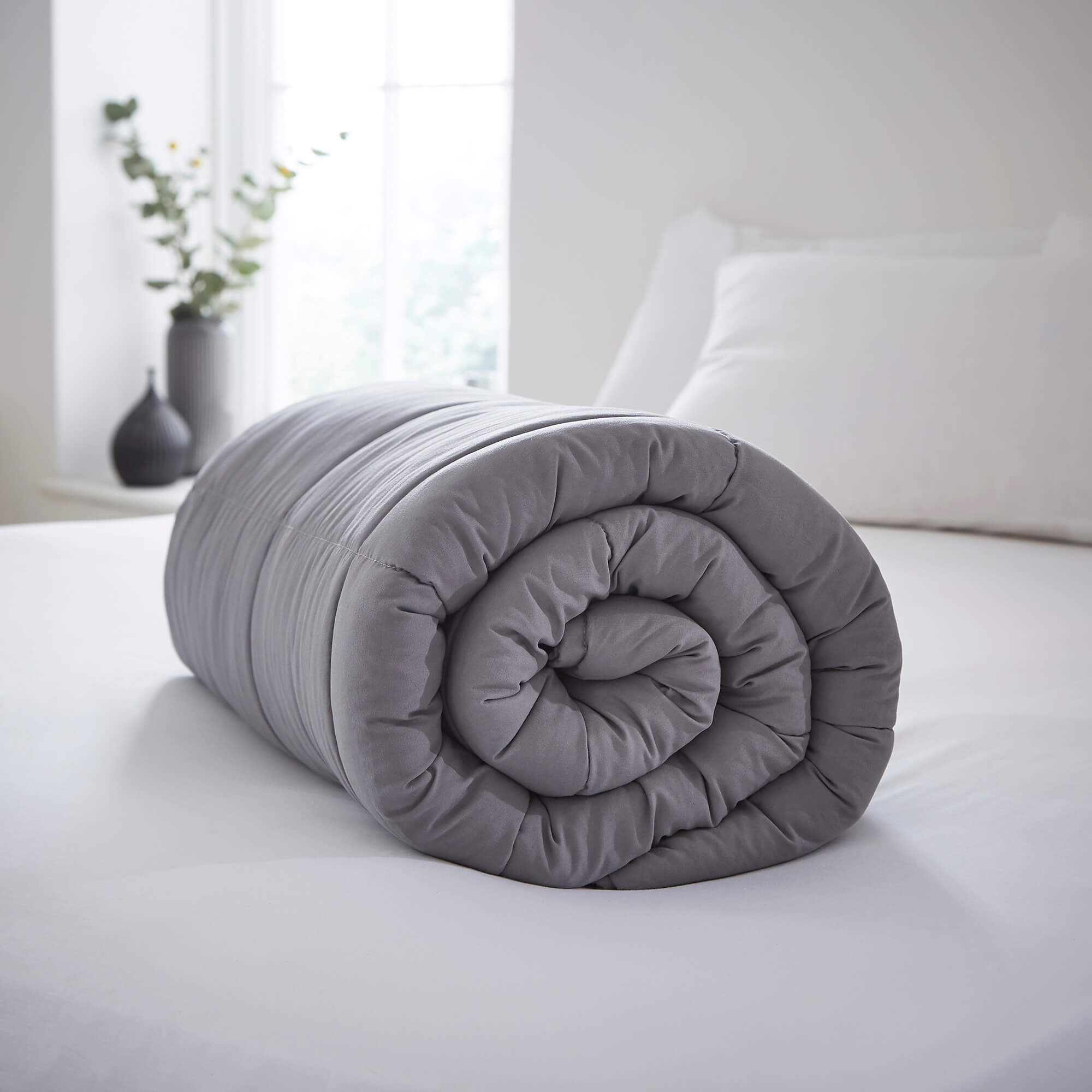 A rolled up weighted blanket