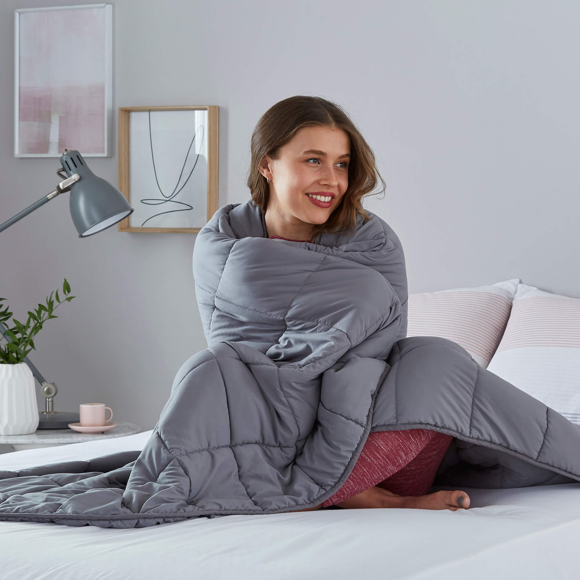 A woman wrapped in a weighted blanket