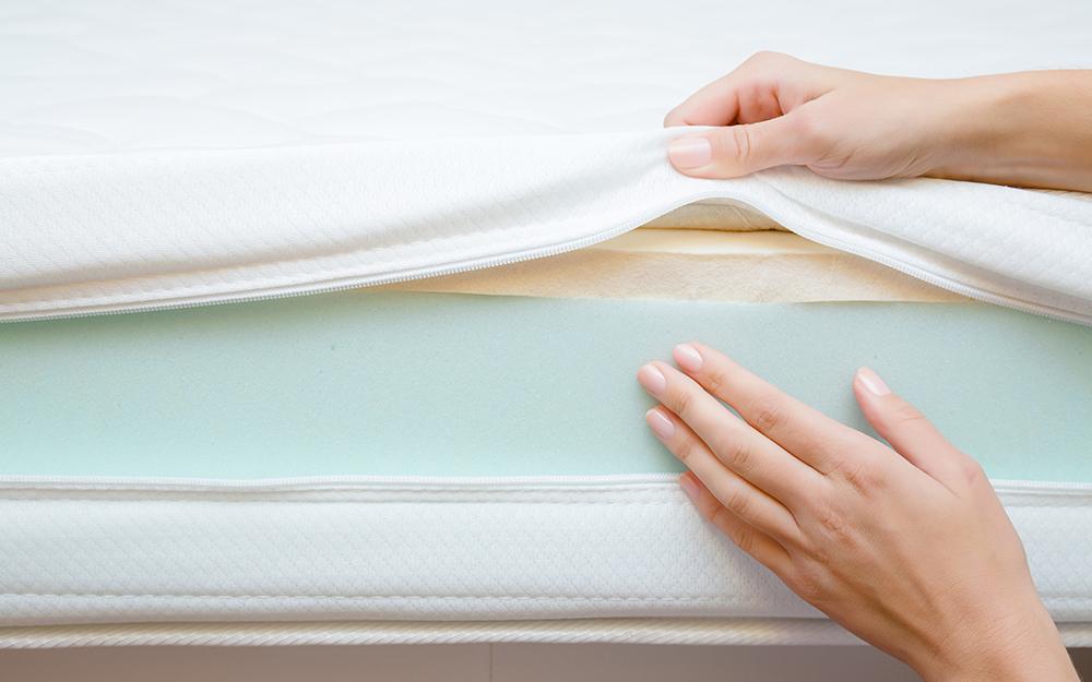 Woman showing the foam inside a mattress
