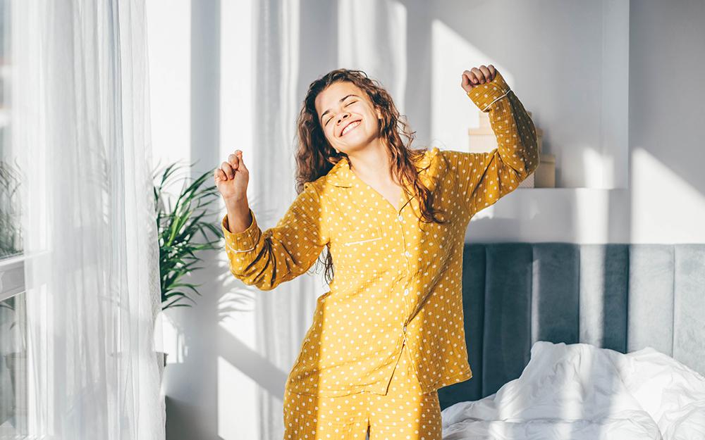 Woman smiling in pyjamas
