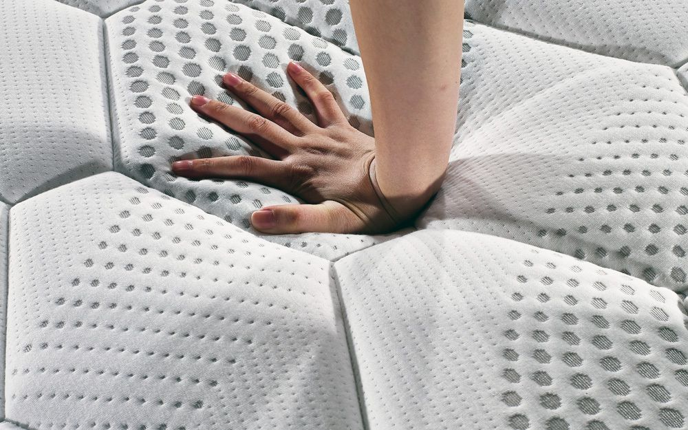 A reflex foam mattress showing the response against a hand when pressure is applied