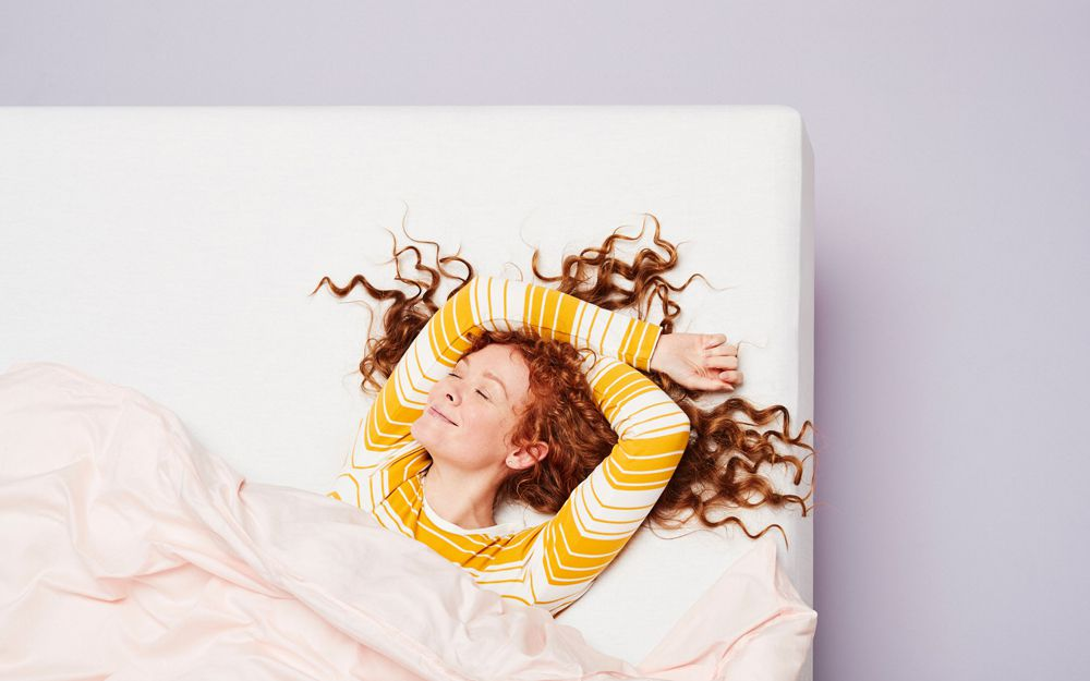 Woman lying on Casper mattress