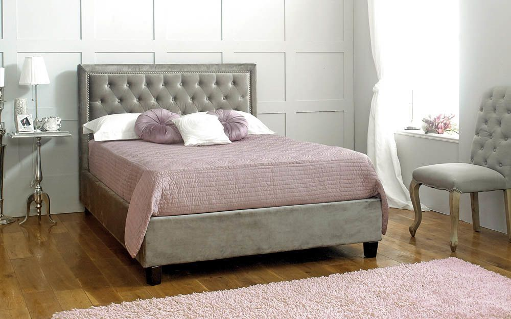 The Limelight Rhea Fabric Bed Frame, with button-detail headboard in a stylish bedroom
