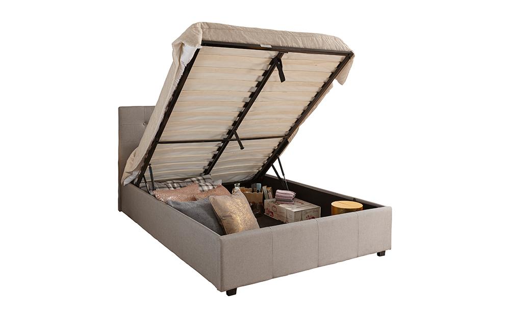 The GFW Regal Grey Fabric Ottoman Bed with open ottoman showcasing plentiful storage space