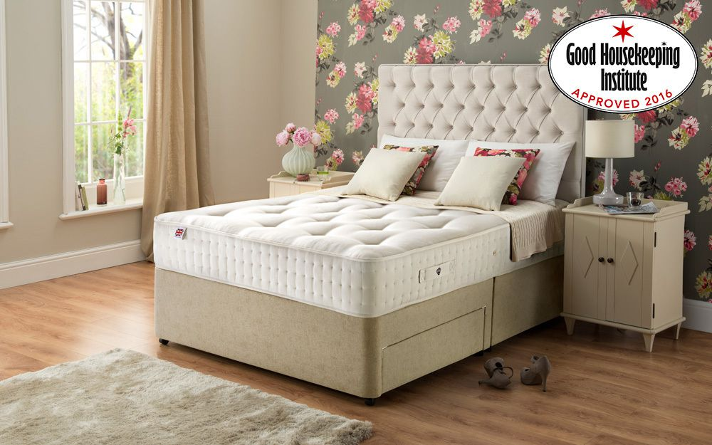 The platform base Rest Assured Adleborough 1400 Pocket Ortho Divan Bed in a bedroom, displaying its Good Housekeeping Institute Award award