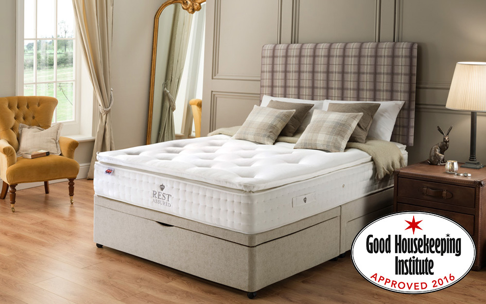 The platform base Rest Assured Knowlton 2000 Pocket Latex Divan Bed in a bedroom, displaying the Good Housekeeping Institute Award icon