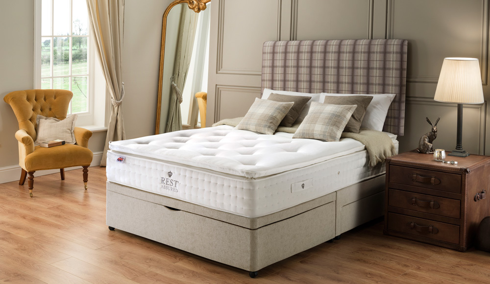 The Rest Assured Knowlton 2000 Pocket Latex Divan Bed with half ottoman storage and two drawers
