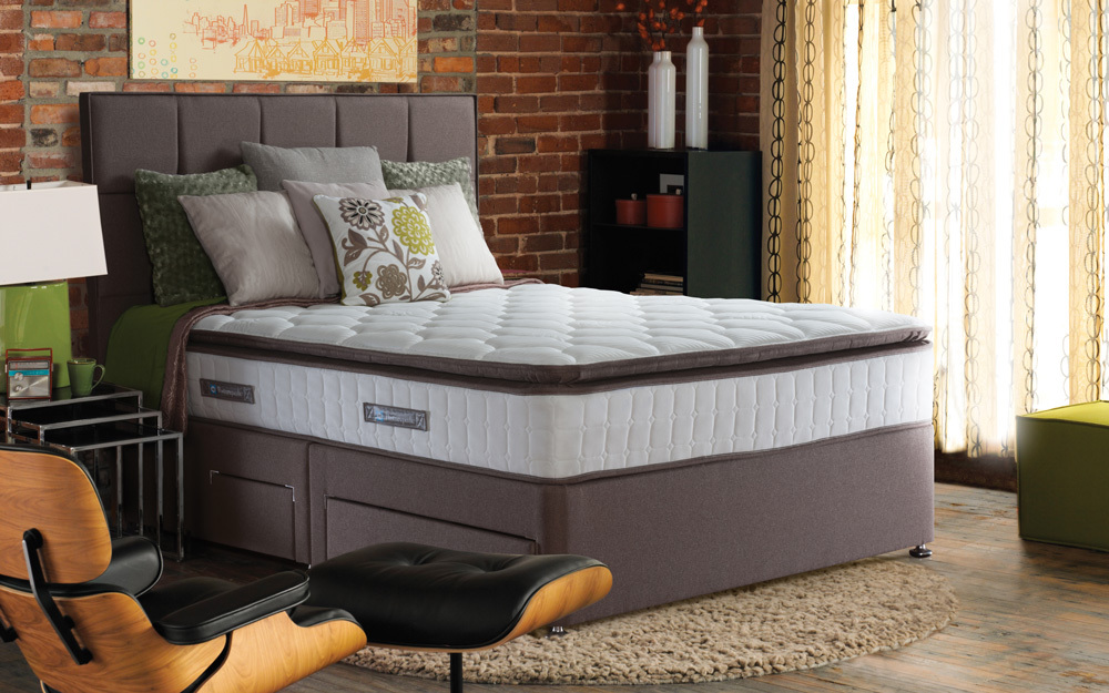 The Sealy Nostromo Posturepedic Pocket 1400 Latex Divan in pewter with four drawers and matching headboard