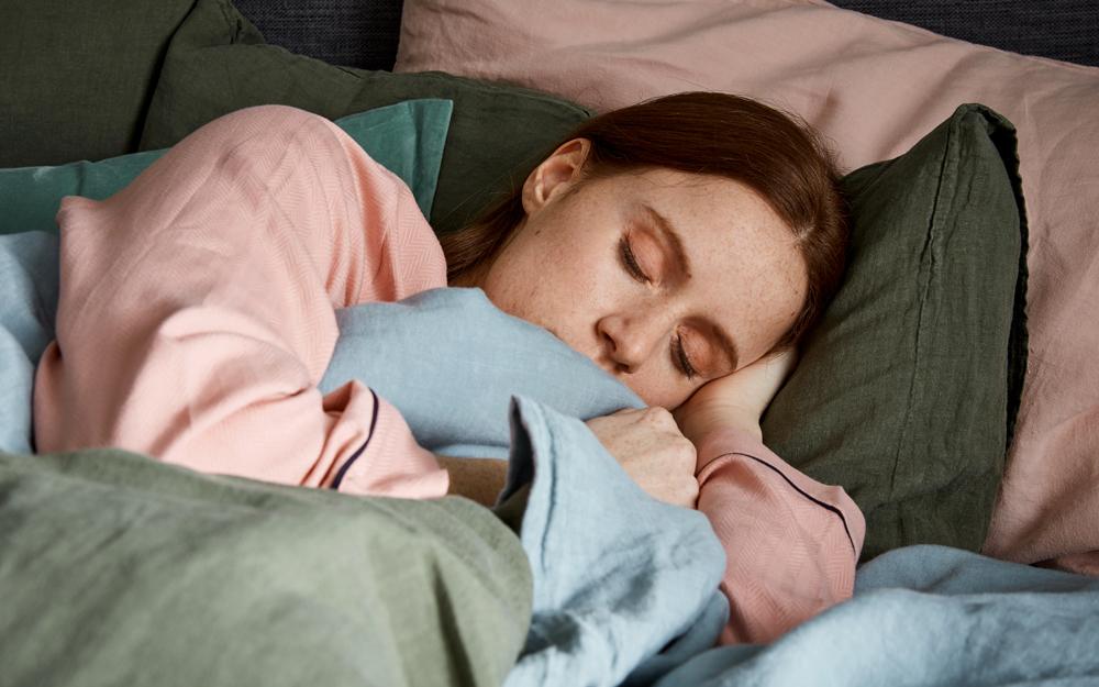 Woman sleeping on pillows