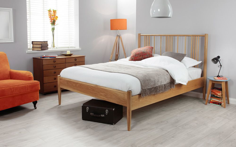The Silentnight Hamilton Solid Oak Bed Frame features a spindle headboard and low foot end, with tapered legs