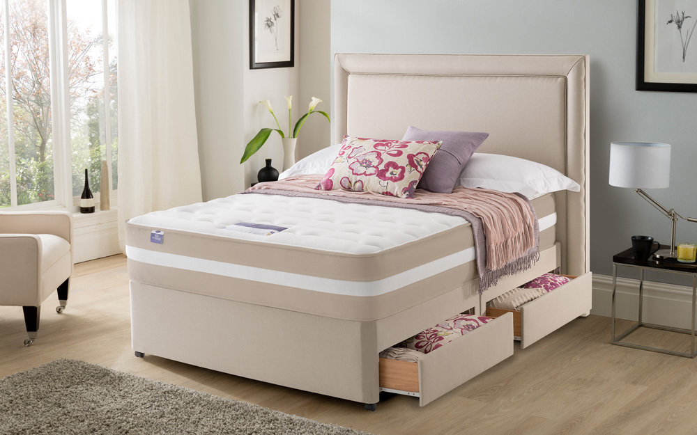 The platform base Silentnight London 2000 Mirapocket Memory Divan Bed in a bedroom, showing open drawer storage