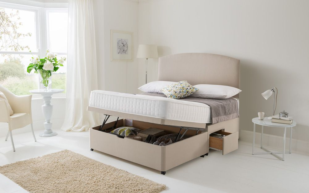 The Silentnight Essentials Pocket 1000 Divan Bed, with a half-opening ottoman storage compartment opening from the end of the bed, plus drawers