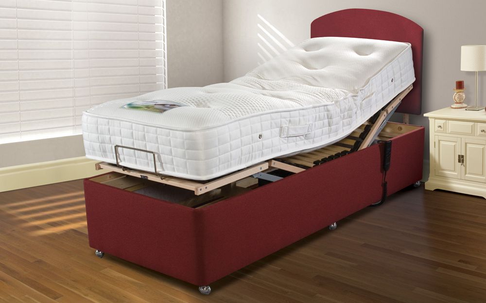 The Sleepeezee Latex 1000 Adjustable Divan Bed and Mattress with the top of the mattress lifted up to show the adjustable bed underneath