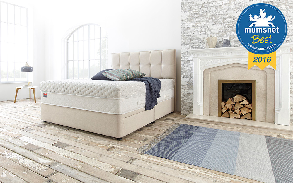 The Slumberland Serene 3300 Pocket Divan Bed in a bedroom with two drawers
