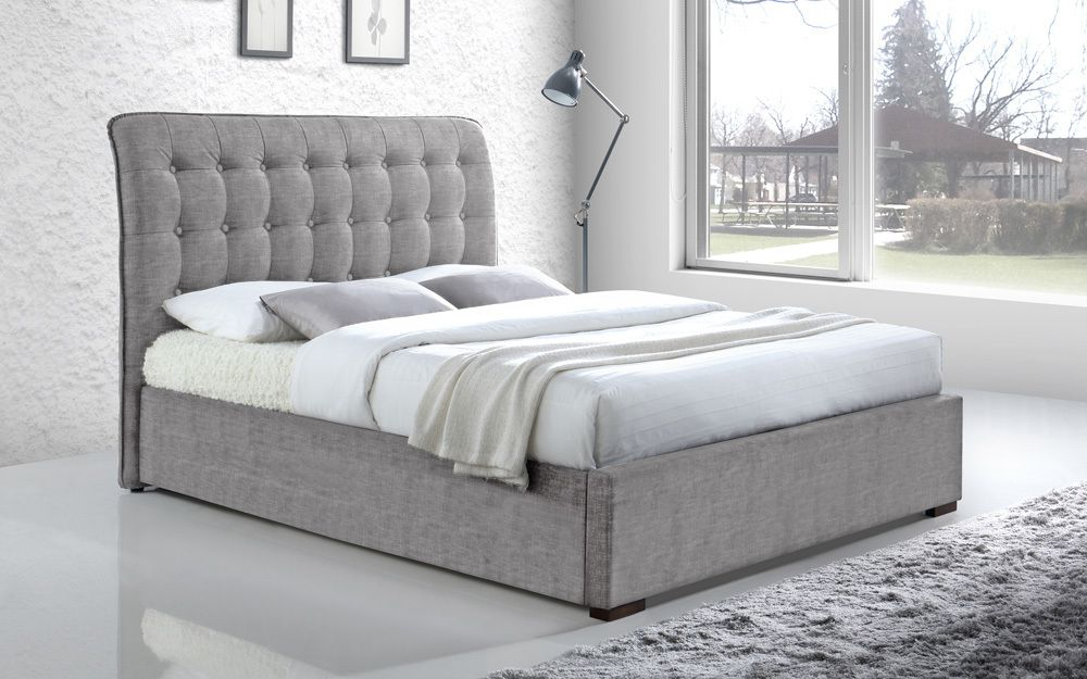 The Limelight Hamilton Fabric Bed Frame, with button-detail headboard in a stylish bedroom
