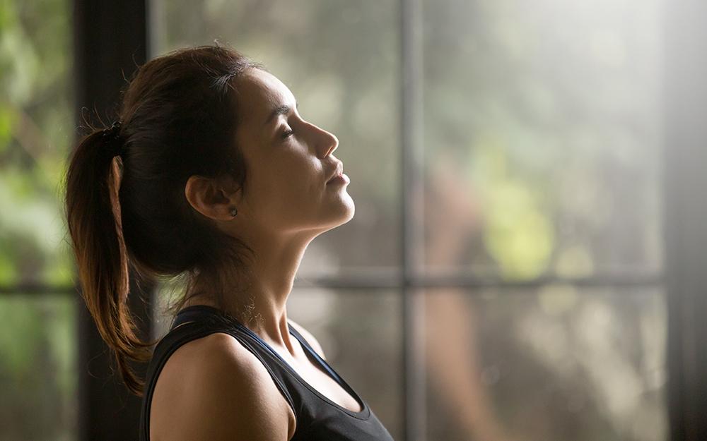 Woman breathing in deeply